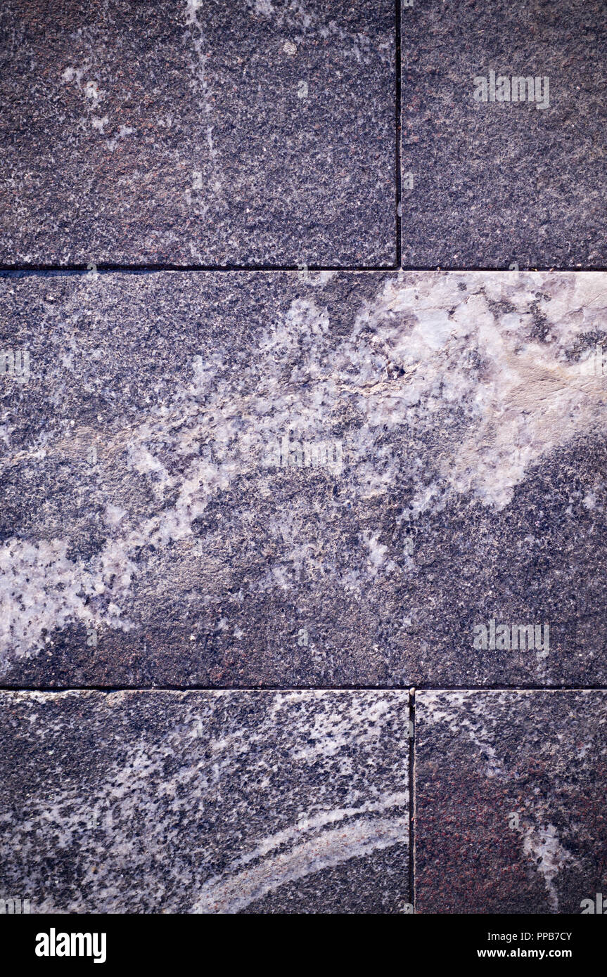 grey granite stone tiled background with vignette. architecture, texture. - Stock Image