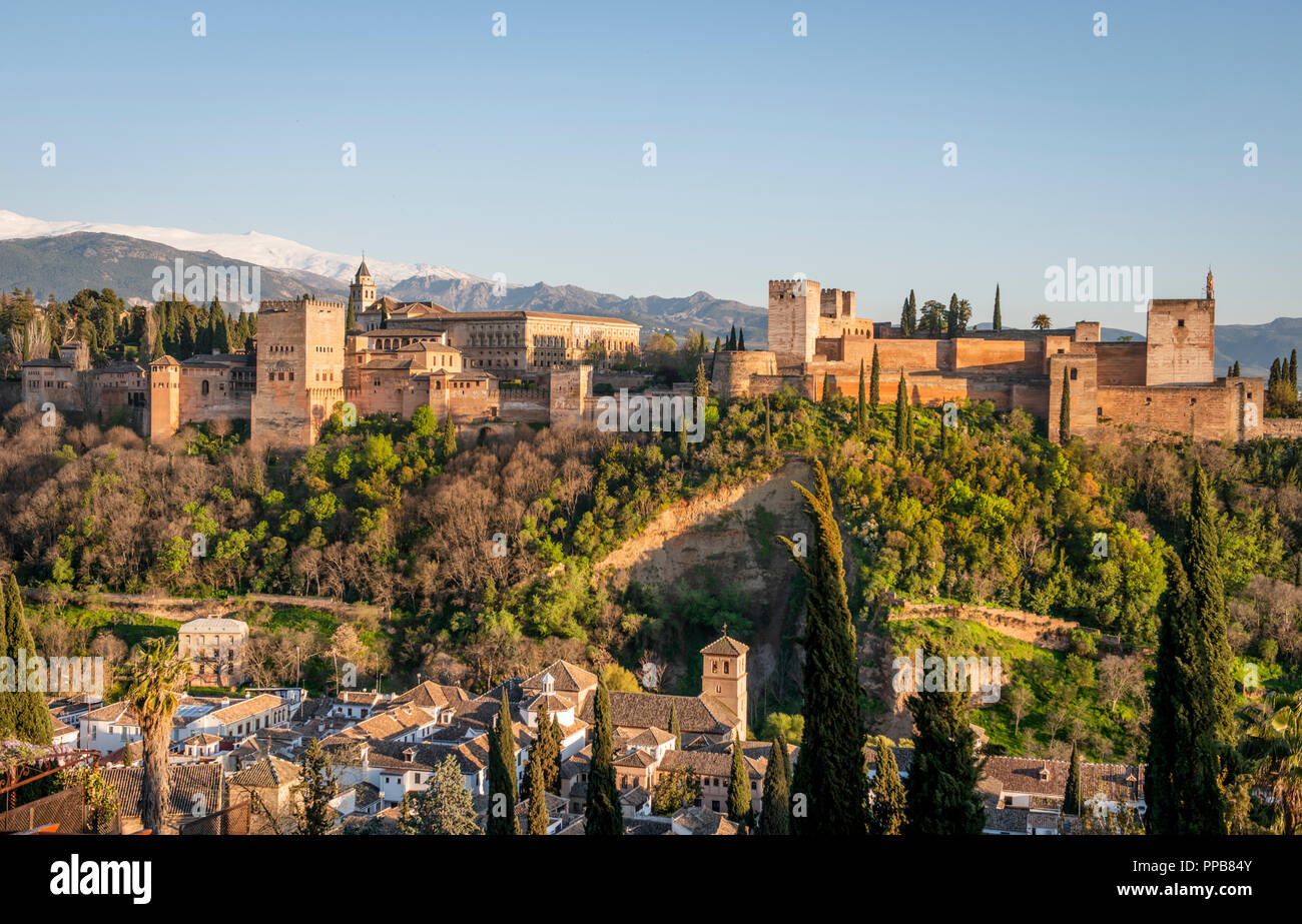 Alhambra on the Sabikah hill, Moorish citadel, Nasrid palaces, Palace of Charles the Fifth, behind Sierra Nevada with snow - Stock Image