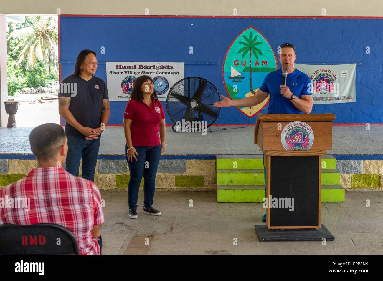 BARRIGADA, Guam (Aug. 18, 2018) Capt. Steven Stasick, commodore 30th Naval Construction Regiment (30NCR), thanks Barrigada's mayor and vice mayor for conducting a welcome fiesta for the 30NCR. The Village of Barrigada is 30NCR's sister village and the two will conduct community service projects and other functions together. 30NCR relocated to Guam from Port Hueneme, California, July 1. - Stock Image