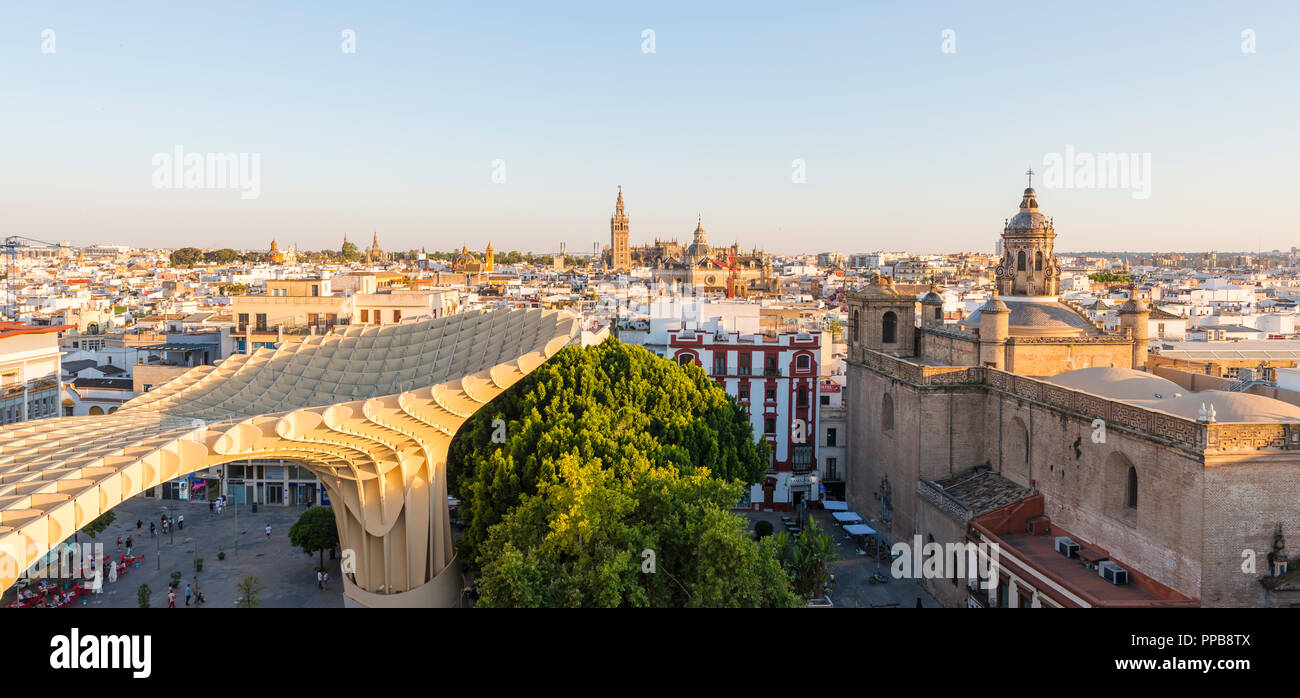 Cityscape, view over Seville, La Giralda and Iglesia del Salvador, Metropol Parasol, curved wooden structure - Stock Image