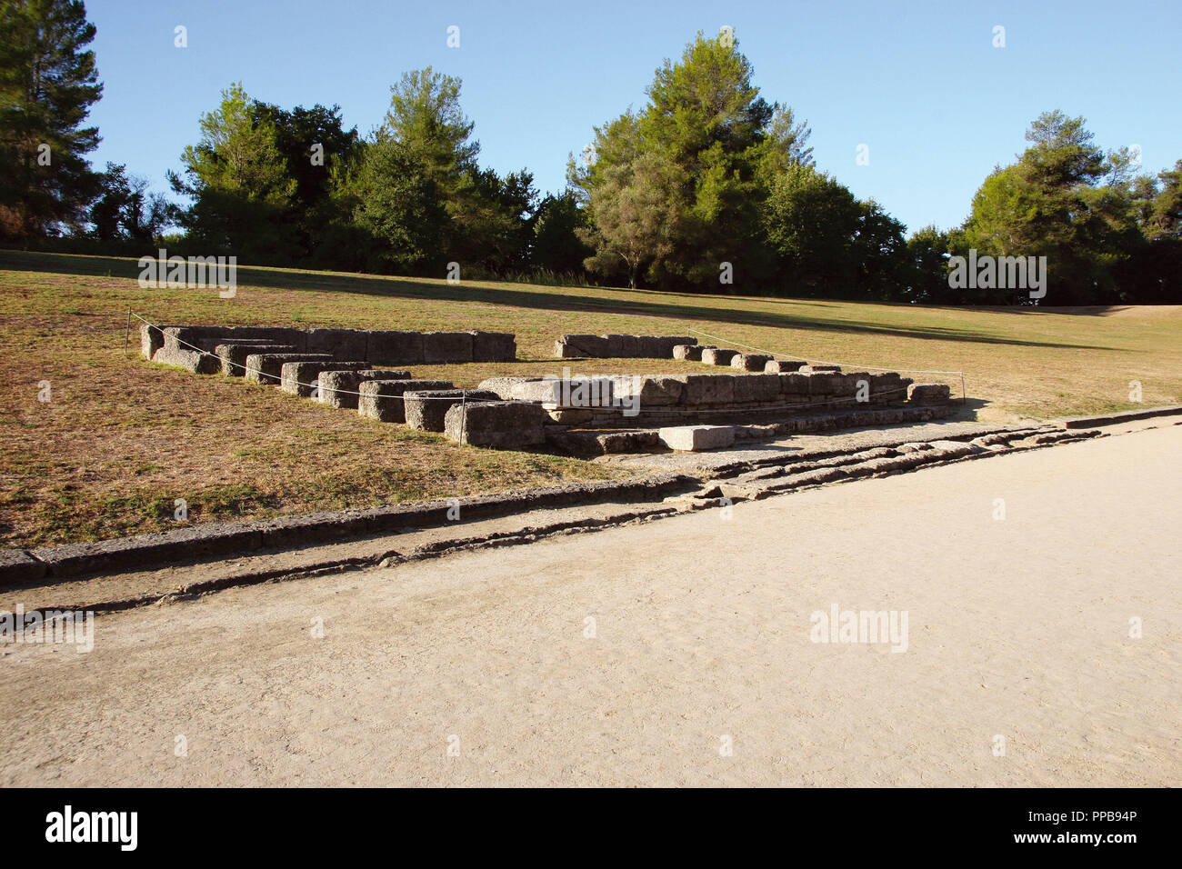 Greek Art. Sanctuary of Olympia. The ancient Olympic Stadium. Remains of the Judges Platform (Hellanodikes). The east of archaelogical site.  Elis. Peloponesse. Greece. Europe. - Stock Image