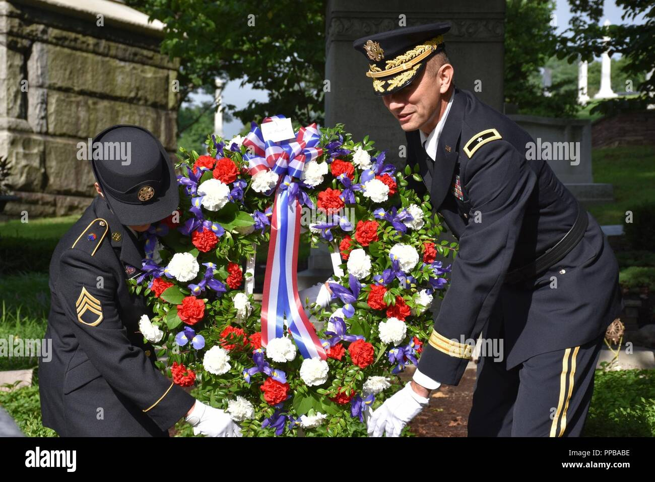 Brigadier Gen. Tony L. Wright, 88th Readiness Division deputy commanding general (right), and Staff Sgt. Jill Spencer (left), 88th RD executive assistance to the commanding general, lay a wreath at ceremony for President Benjamin Harrison at Crown Hill Cemetery, in Indianapolis, on Aug. 18, to commemorate the Hoosier President's 185th birthday. (US Army Stock Photo