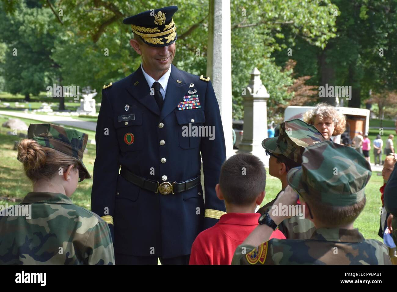 Brigadier Gen. Tony L. Wright, 88th Readiness Division deputy commanding general, answers questions from members of the Central Indiana Young Marines following a wreath laying ceremony for President Benjamin Harrison at Crown Hill Cemetery, in Indianapolis, on Aug. 18, to commemorate the Hoosier President's 185th birthday. (US Army Stock Photo