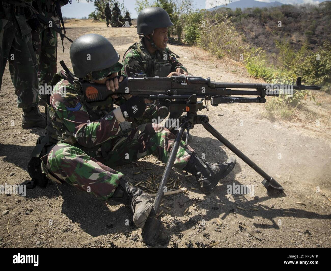 INDONESIA (Aug  17, 2018) - An Indonesian marine fires his machine