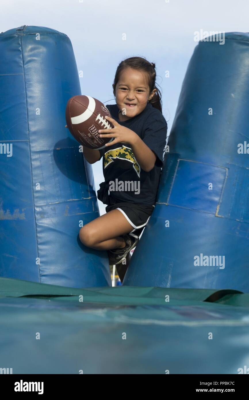 A Child Of A Service Member Participates In The Chargers Nfls Play
