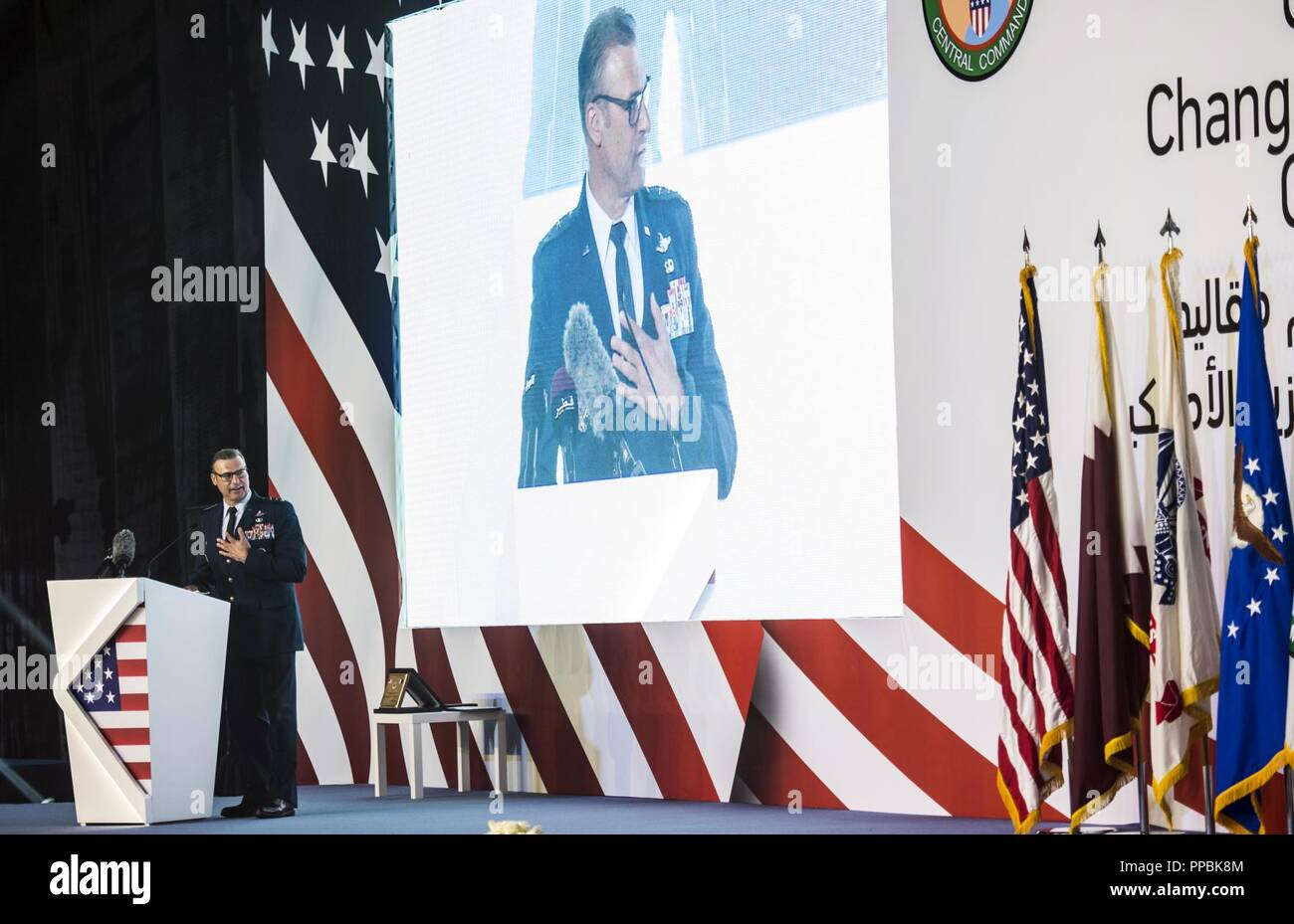 U.S. Air Force Lt. Gen. Joseph T. Guastella Jr., Commander of U.S. Air Forces Central Command (AFCENT), speaks to attendees at a change of command ceremony at Al Udeid Air Base, Qatar, Aug. 30, 2018. Guastella is a command pilot and has accumulated more than 4,000 flying hours, including 1,000 combat hours in the F-16C/D and the A-10C. AFCENT is headquarters at Shaw Air Force Base, South Carolina, and has a forward headquarters at Al Udeid Air Base Qatar. As the air component of U.S. Central Command, AFCENT is responsible for air operations, either unilaterally or in concert with coalition par - Stock Image