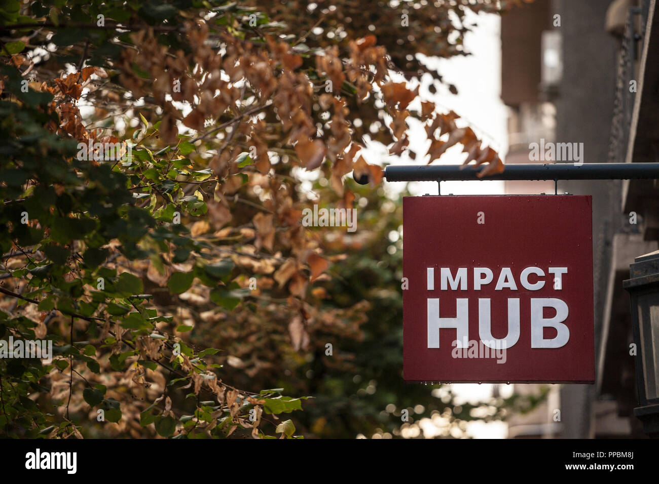 BELGRADE, SERBIA - SEPTEMBER 24, 2018: Logo of Impact Hub on their office in Belgrade. ImpactHub is a startup incubatore providing coworking and offic - Stock Image