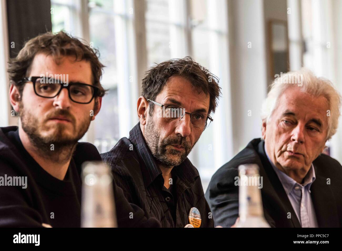 Munich, Bavaria, Germany. 25th Sep, 2018. Fred Heussner of the NoPAGBY organization, Thomas Lechner, who organized the NoPAG demonstration, and civil rights expert Hartmut Waechtler. Citing the increasing politics of fear and attacks on civil and human rights, some 55 civil groups, organizations, and political parties have organized a follow up to the successful Munich NoPAG demonstration against the PAG Police Assignment Laws. The groups state that the increasingly exclusionary and populistic politics of the CSU and the AfD, along with the Polizeiaufgabengesetze (PAG Police Assignment - Stock Image