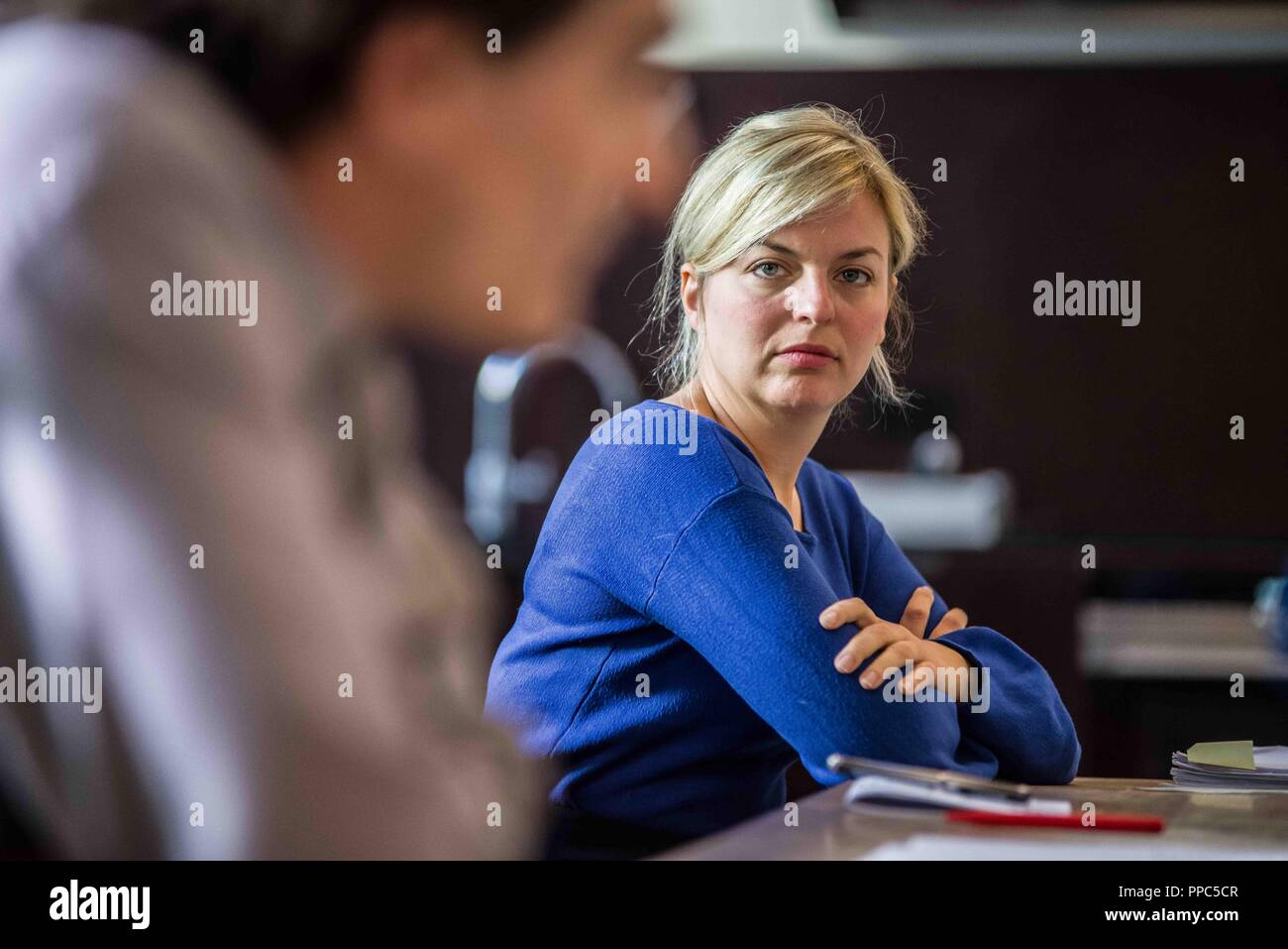 Munich, Bavaria, Germany. 25th Sep, 2018. KATHARINA SCHULZE of the Green Party looks on while ATES GUERPINAR of die Linke speaks. Citing the increasing politics of fear and attacks on civil and human rights, some 55 civil groups, organizations, and political parties have organized a follow up to the successful Munich NoPAG demonstration against the PAG Police Assignment Laws. The groups state that the increasingly exclusionary and populistic politics of the CSU and the AfD, along with the Polizeiaufgabengesetze (PAG Police Assignment Laws) are turning citizens into objects, which is a p - Stock Image