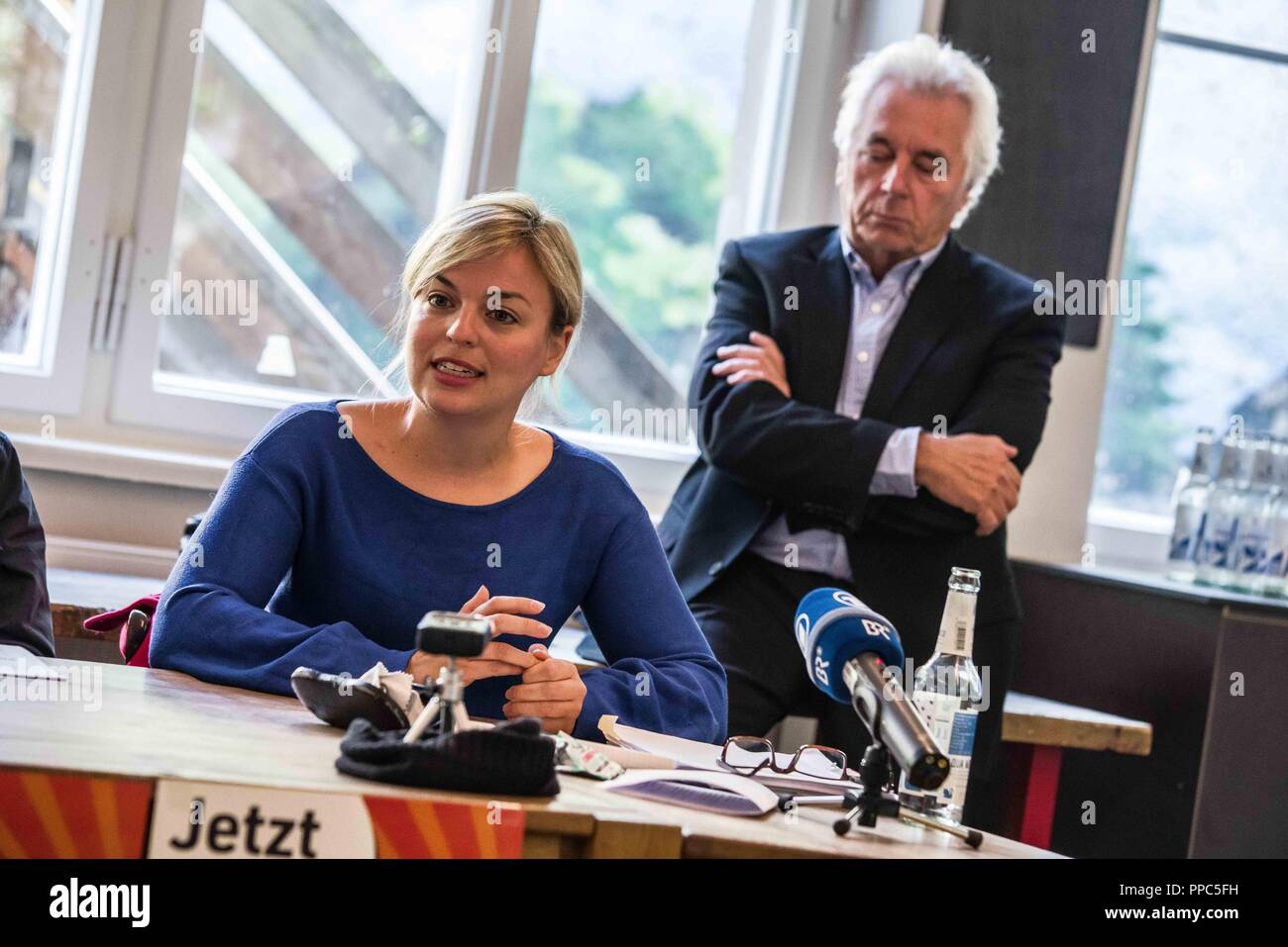 Munich, Bavaria, Germany. 25th Sep, 2018. KATHARINA SCHULZE of the Green Party with HARTMUT WAECHTLER behind. Citing the increasing politics of fear and attacks on civil and human rights, some 55 civil groups, organizations, and political parties have organized a follow up to the successful Munich NoPAG demonstration against the PAG Police Assignment Laws. The groups state that the increasingly exclusionary and populistic politics of the CSU and the AfD, along with the Polizeiaufgabengesetze (PAG Police Assignment Laws) are turning citizens into objects, which is a prerequisite for aut - Stock Image