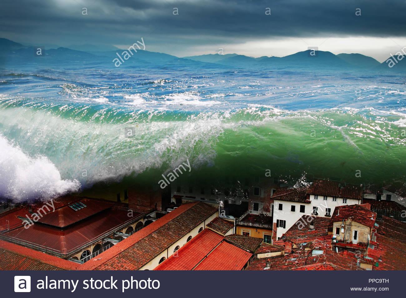 Great wave crashing above the city. Global flood. - Stock Image