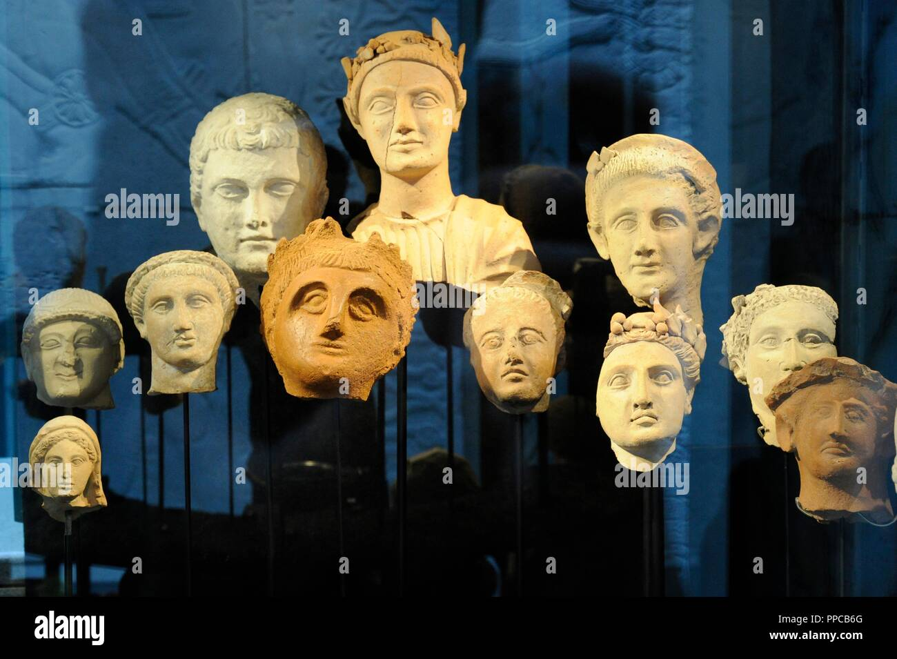 Heads of men and women. Terracotta and limestone. 7th century BC- 1st century AD. From Marion and Mersinaki, Cyprus. Museum of Mediterranean and Near Eastern Antiquities. Stockholm. Sweden. - Stock Image