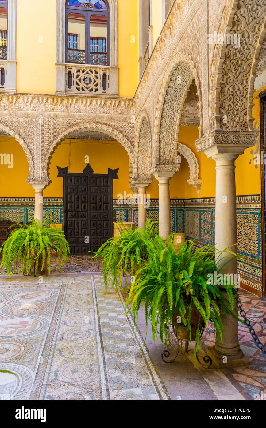16th century palace, Moorish architecture, courtyard decorated with Roman mosaic, sculptures., Palacio de la Condesa de Lebrija Stock Photo