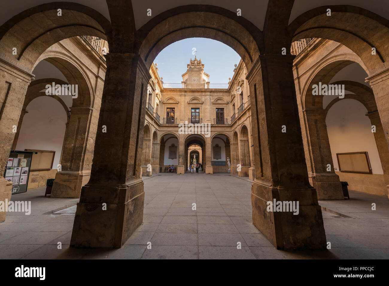 Neo-classical courtyard with arcade, University, former Royal Tobacco Factory, Real Fábrica De Tabacos de Sevilla, Seville - Stock Image