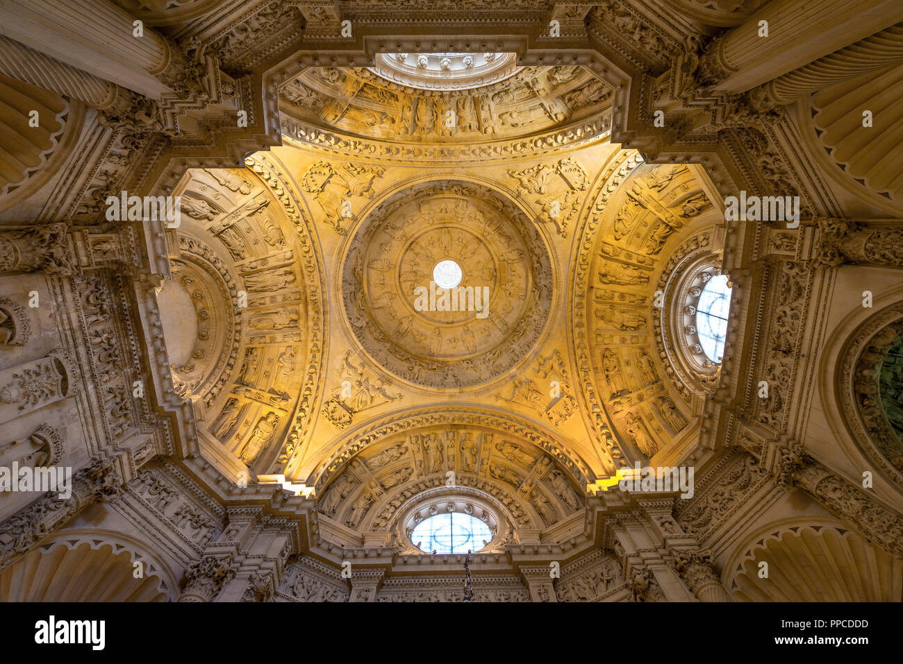 Ornate ceiling vault in the aisle of the Cathedral of Seville, Catedral de Santa Maria de la Sede, Seville, Andalusia, Spain - Stock Image