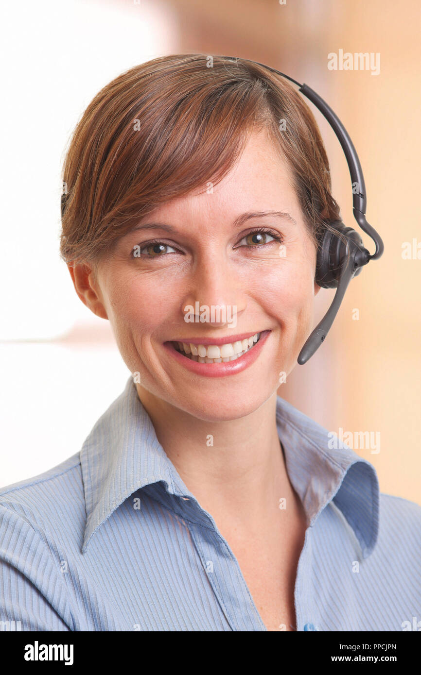 Portrait of smiling young woman telemarketer Stock Photo