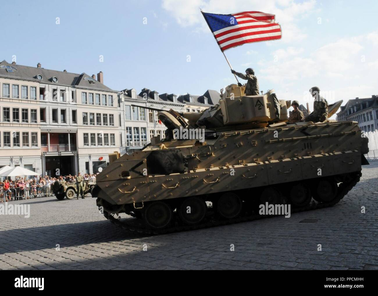 Soldiers and an M2A3 Bradley Fighting Vehicle, both assigned