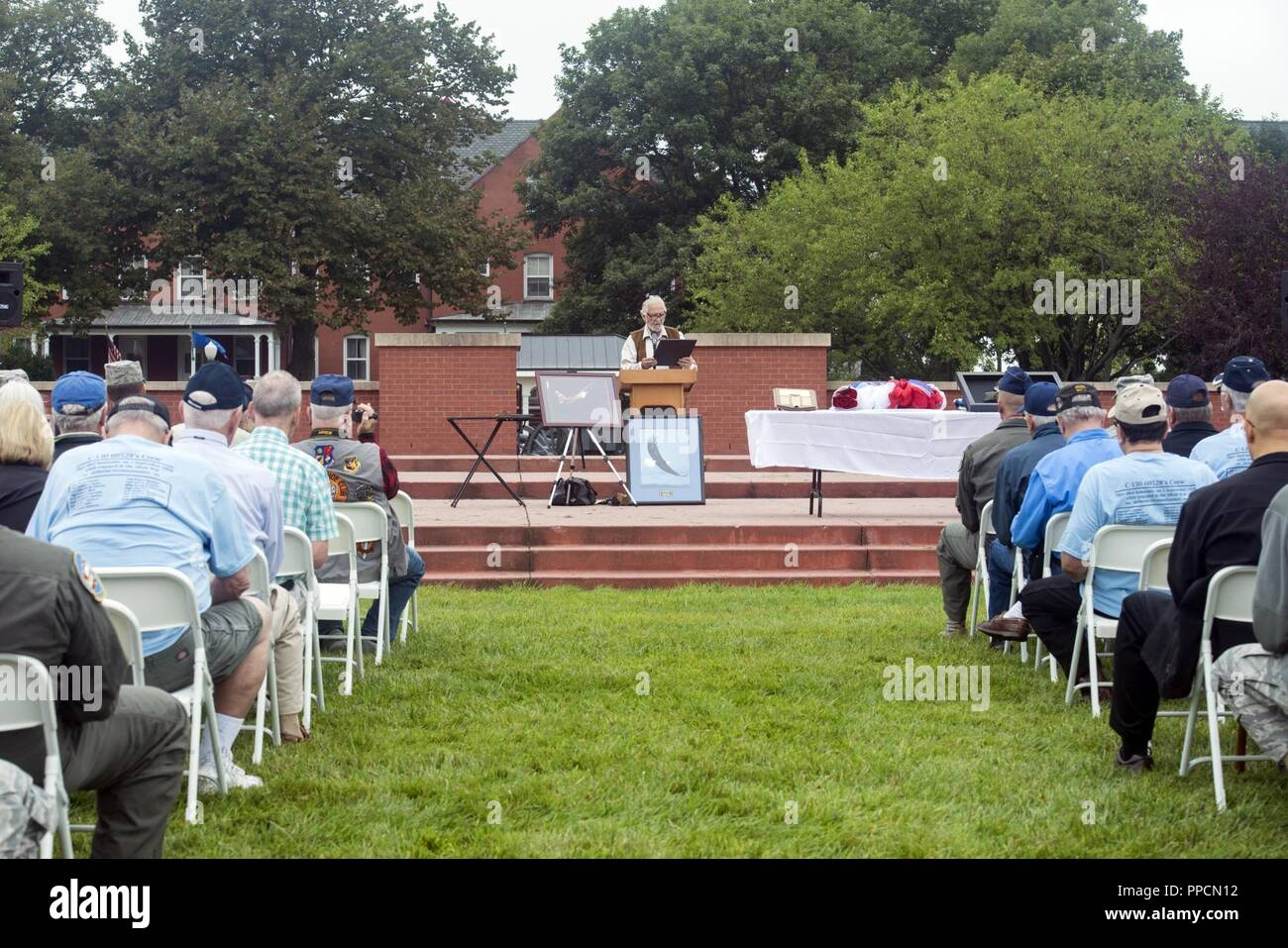 Retired U.S. Air Force Master Sgt. Lonnie Henderson, an intelligence, surveillance and reconnaissance retiree and Prop Wash Gang member, speaks during the 60528 Remembrance Ceremony held Aug. 30, 2018, at Offutt Air Force Base, Nebraska. The ceremony was held to honor the 17 crewmembers who were lost during the Cold War when their C-130, which was modified to fly reconnaissance missions, was shot down. The aircraft's tail number was 60528. The ceremony was attended by members of the Prop Wash Gang, a group of retired Intelligence Surveillance Reconnaissance operators, family members and fellow - Stock Image