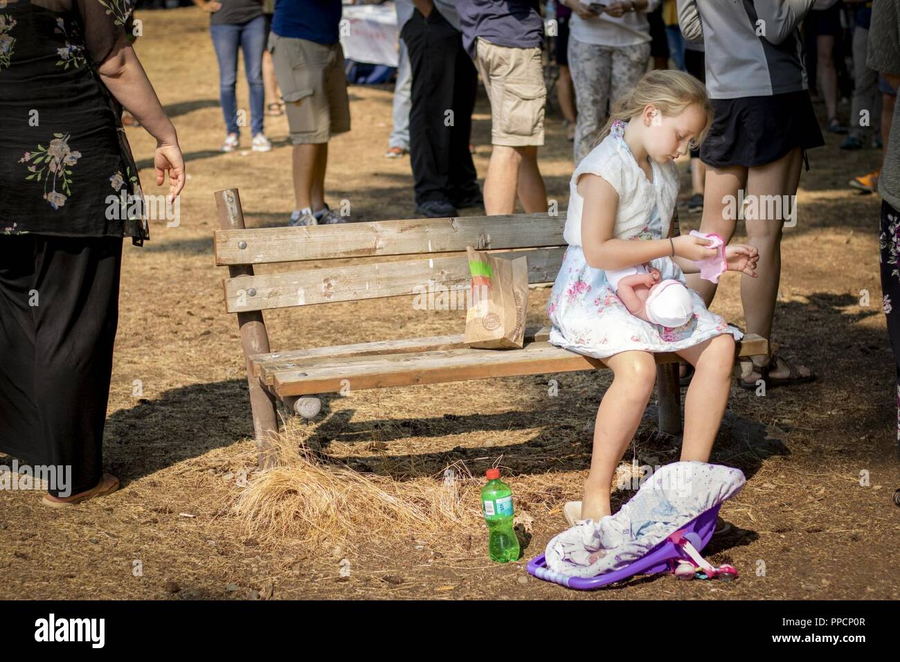 e107518cfcb A girl dresses her baby doll while soldiers and their family members listen  to a briefing given by a military-resource representative during the 104th  ...