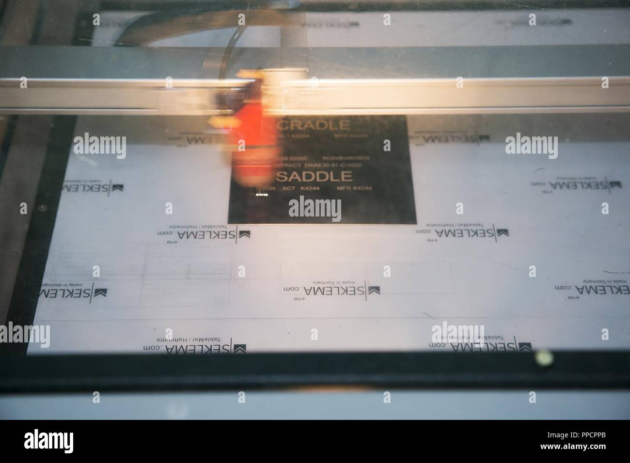 The laser engraving head moves at a speed almost too fast to follow