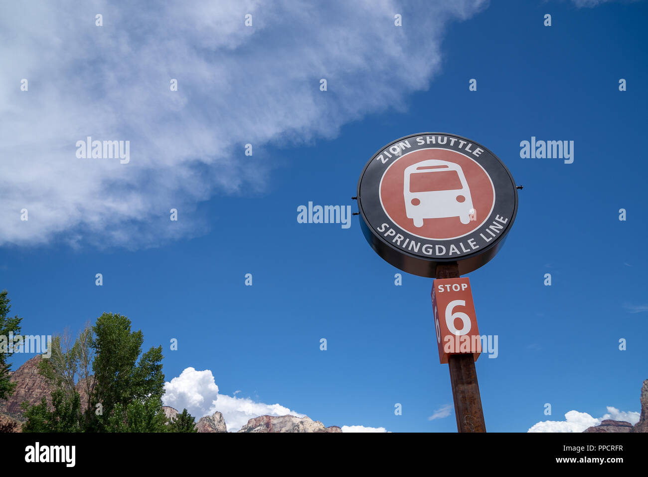 Artistic angle of the Zion National Park shuttle bus stop sign. The shuttle bus is mandatory during the busy summer months for National Park visitors - Stock Image