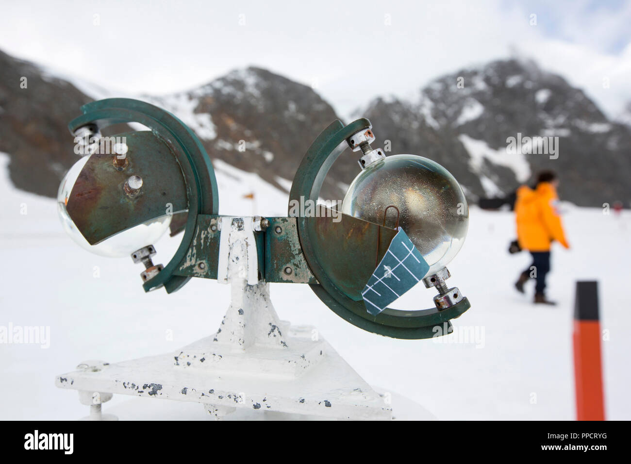 A Campbell Stokes Sunshine Recorder, which measures hours of sunlight at Base Orcadas, which is an Argentine scientific station in Antarctica, and the oldest of the stations in Antarctica still in operation. It is located on Laurie Island, one of the South Orkney Islands, just off the Antarctic Peninsula. The Antarctic Peninsula is one of the fastest warming places on the planet. Stock Photo