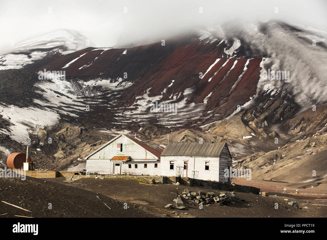 The old British Antarctic Survey station on Deception Island in the South Shetland Islands off the Antarctic Peninsula which is an active volcanic caldera. It was abandoned in 1967 when it was over run by a volcanic eruption. Stock Photo