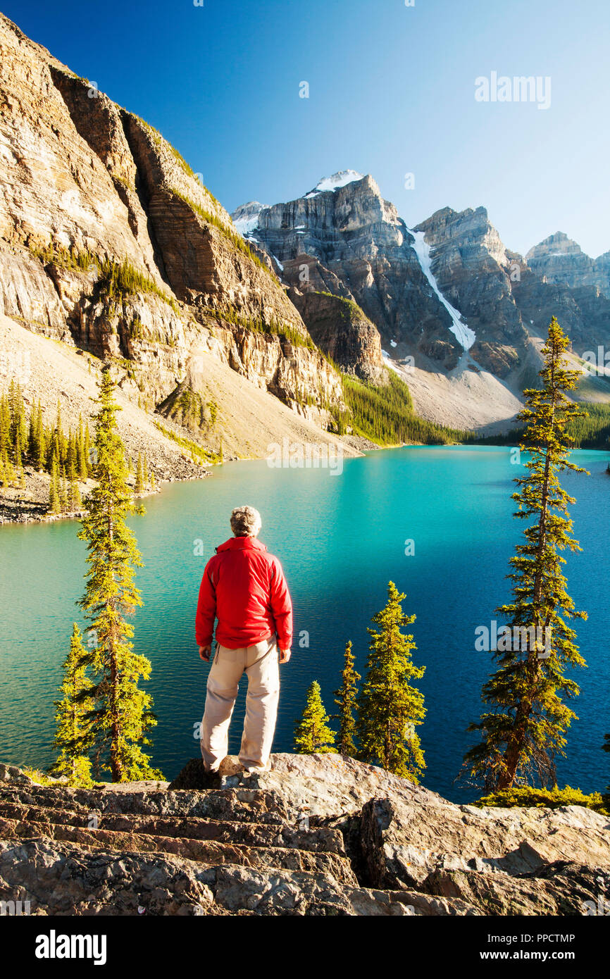 Moraine Lake in the Canadian Rockies is one of the most picturesque, beautiful places in the whole of the Rocky mountains. The green/blue colour of the water is caused by rock flour, from glaciers reflecting diffrent colour wavelengths. Stock Photo