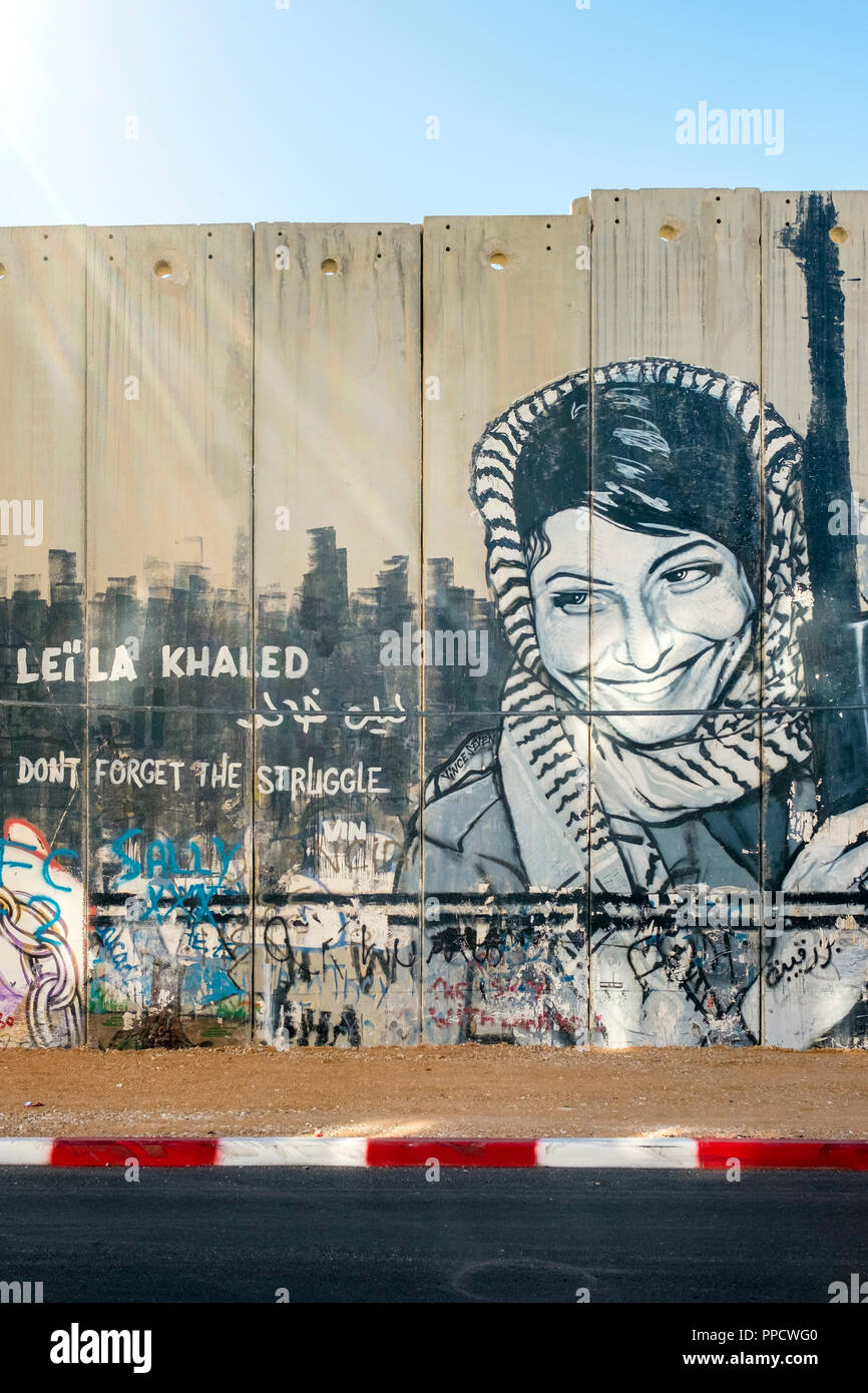 View Of Graffiti Commemorating Leila Khaled On Israeli West Bank Barrier Separation Wall Bethlehem