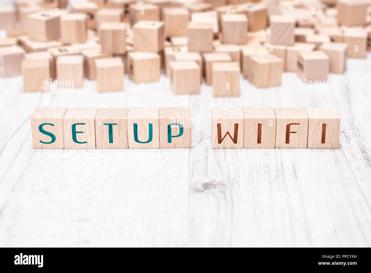 The Words Setup WIFI Formed By Wooden Blocks On A White Table - Stock Image