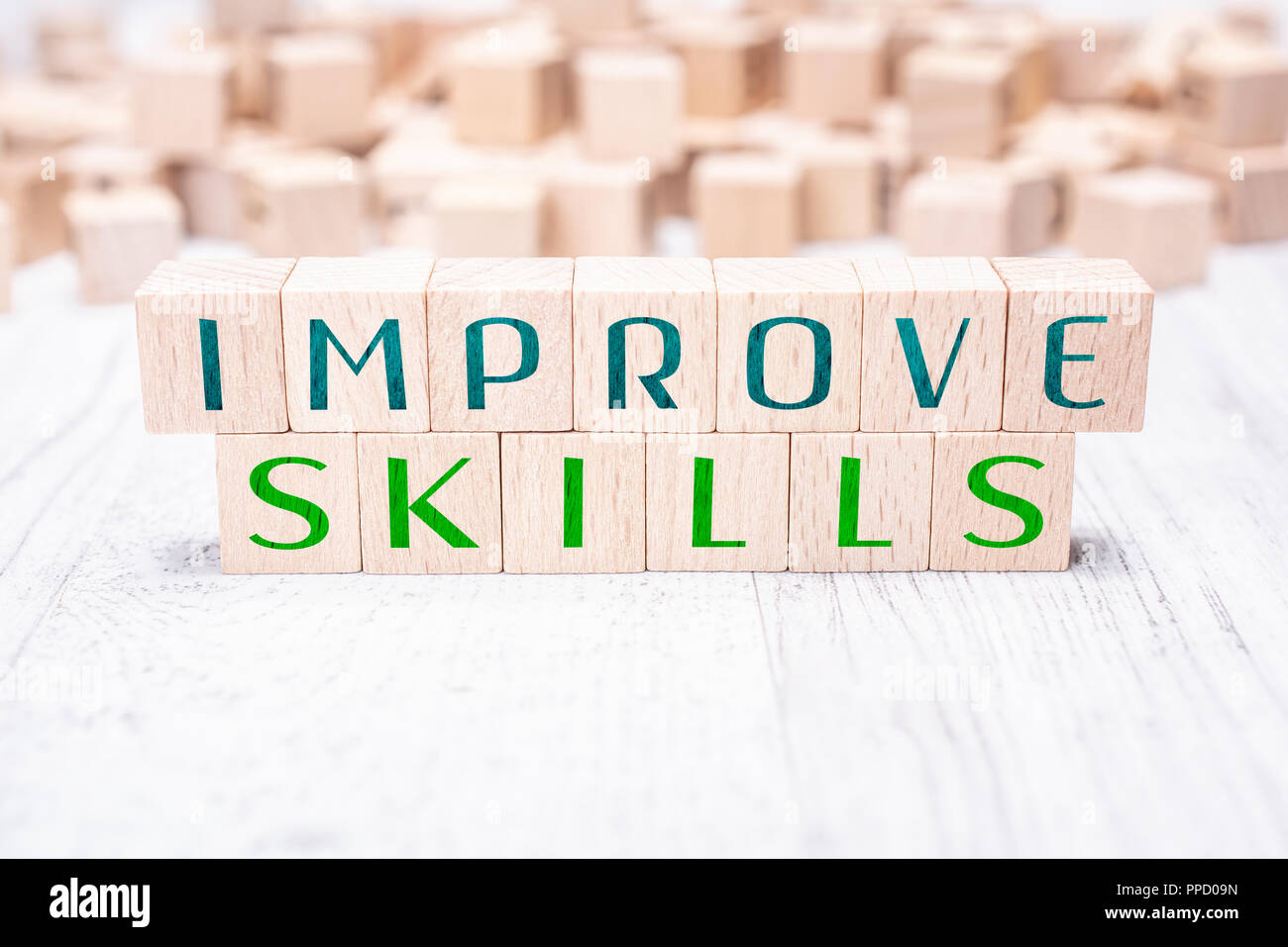 The Words Improve Skills Formed By Wooden Blocks On A White Table - Stock Image