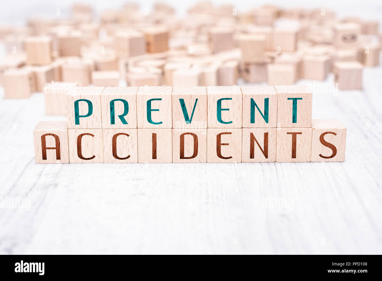The Words Prevent Accidents Formed By Wooden Blocks On A White Table - Stock Image