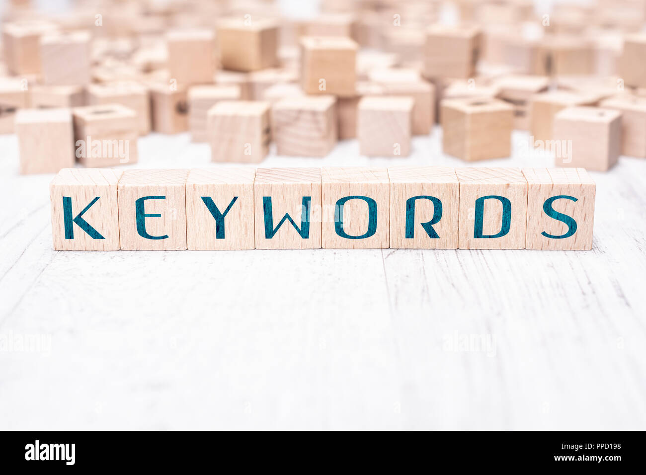 The Word Keywords Formed By Wooden Blocks On A White Table - Stock Image