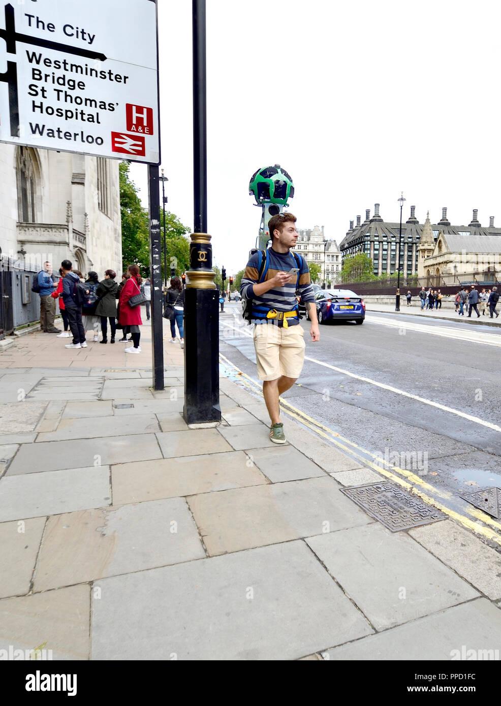 Man in Westminster with Google Trekker 360 degree panoramic camera. London, England, UK. - Stock Image