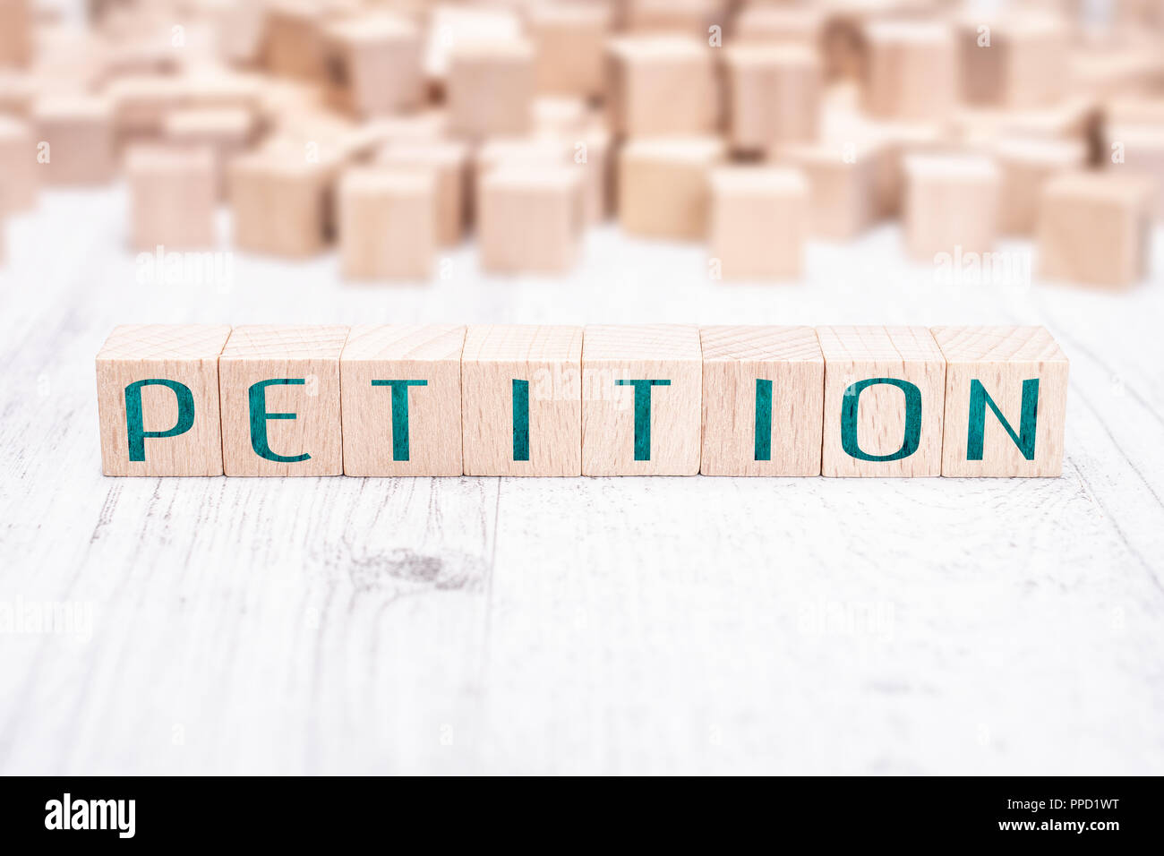 The Word Petition Formed By Wooden Blocks On A White Table - Stock Image