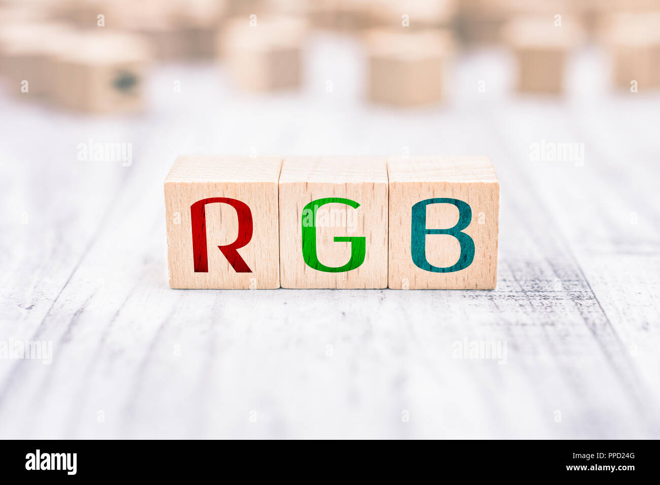 The Abbreviation RGB Formed By Wooden Blocks On A White Table - Stock Image