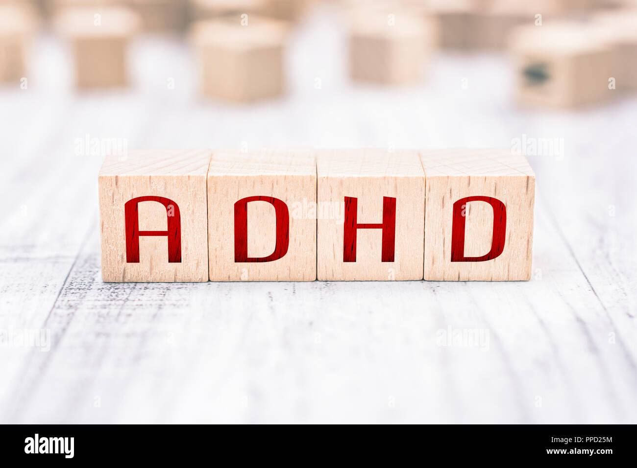 The Abbreviation ADHD Formed By Wooden Blocks On A White Table - Stock Image