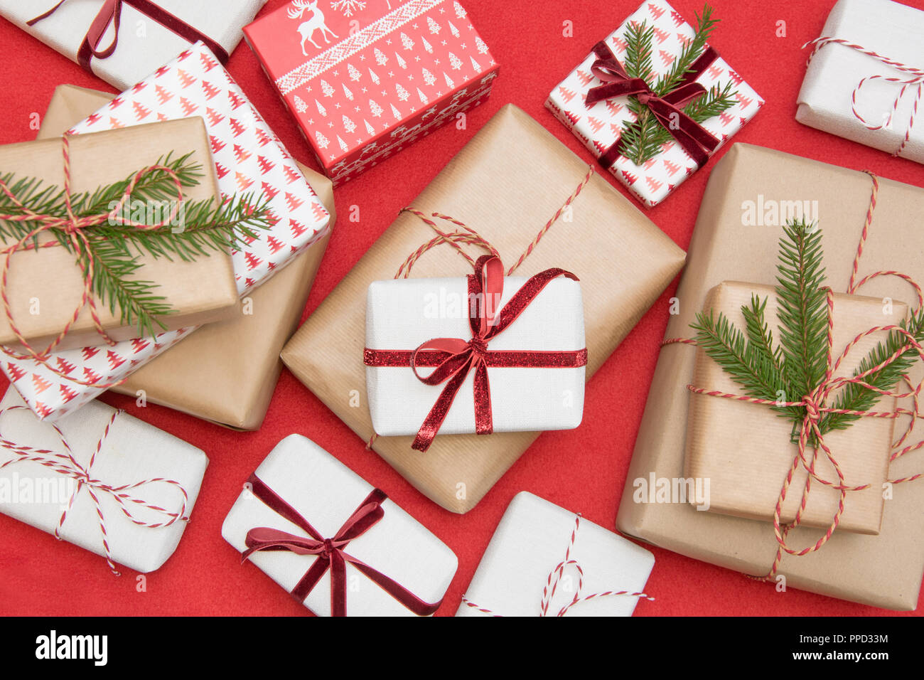 Christmas gift box wrapped in ornament paper and decorative red rope ...