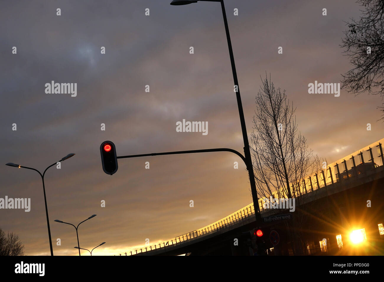 Evening mood at the entrance to the A9 motorway Munich - Nuremberg ('Tatzelwurm') at Freimann. - Stock Image