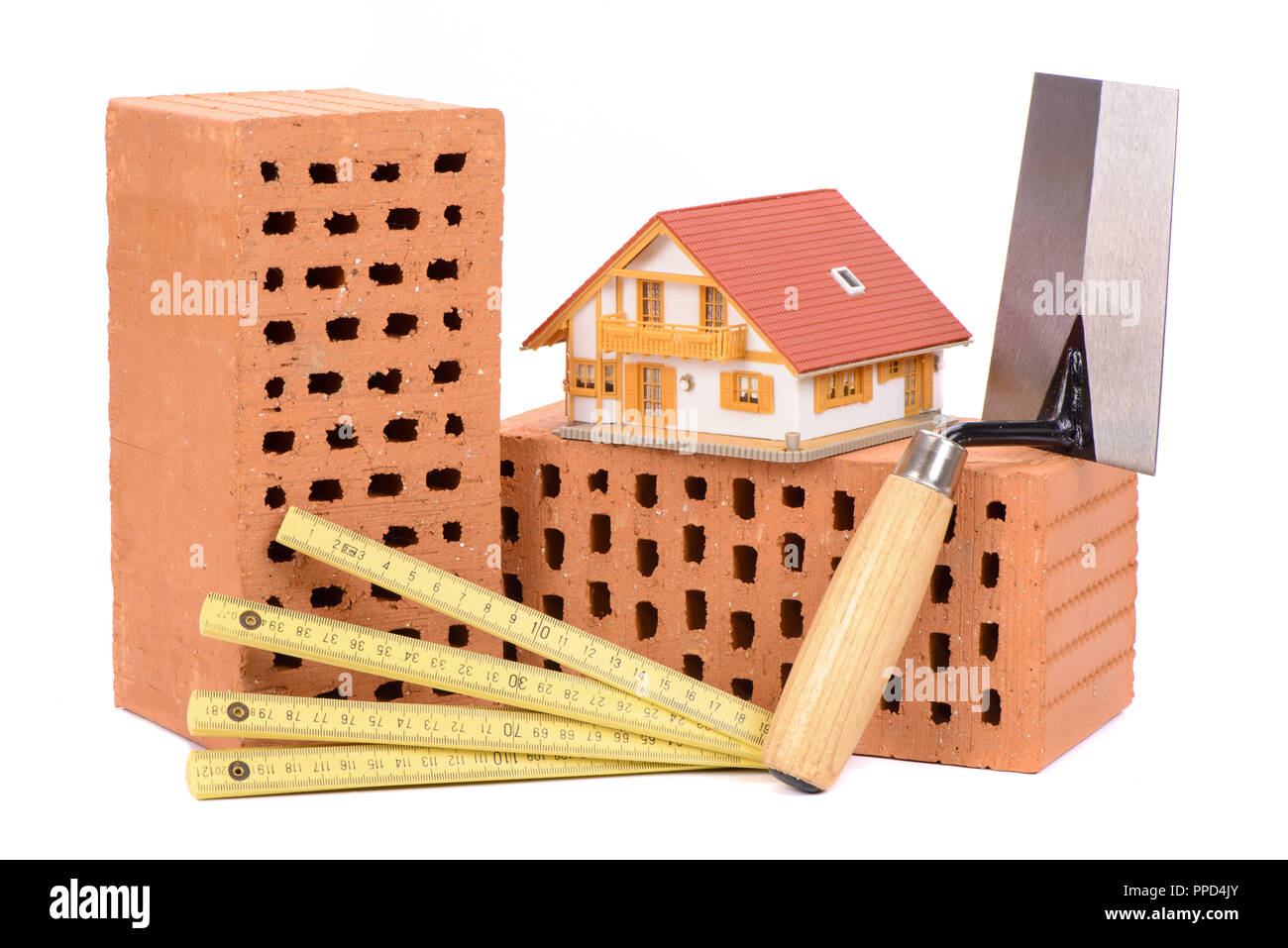 Brick for house construction with tool - Stock Image