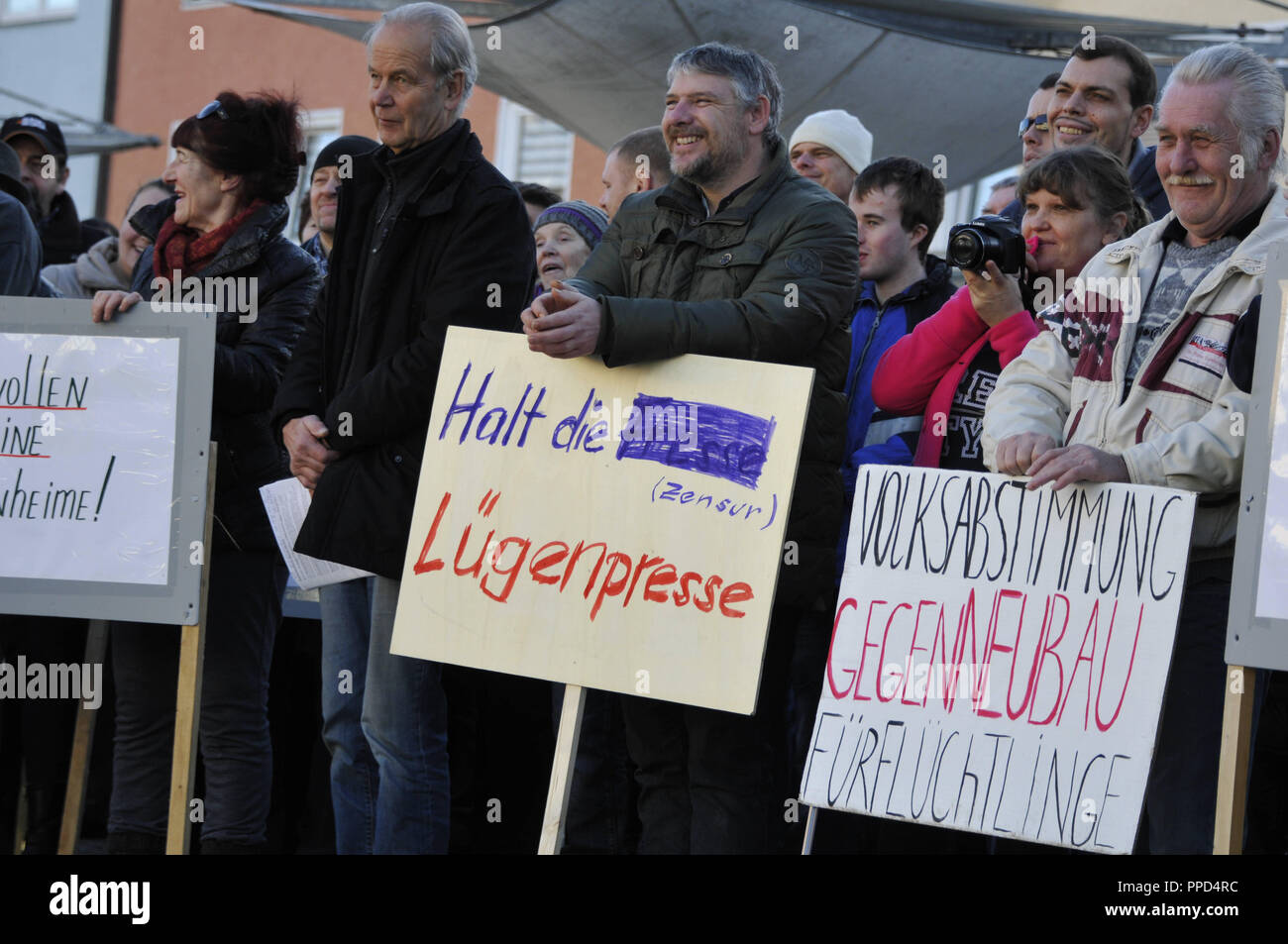 Russian Germans gather in the town square of Traunreut to demonstrate against the refugee policies of Angela Merkel, the Islam and the alleged lying press. - Stock Image