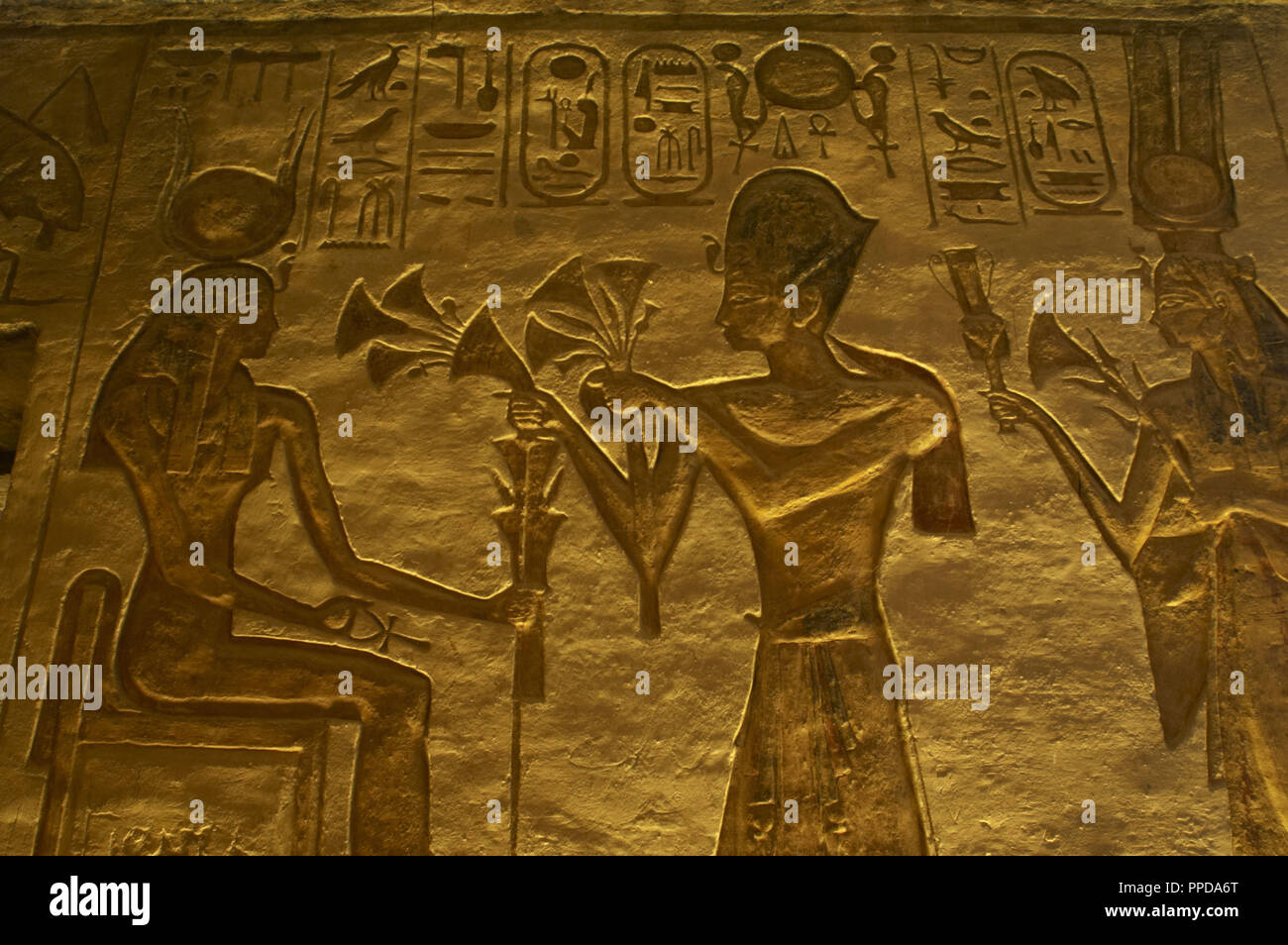 Egyptian art. Great Temple of Ramses II. 19th Dynasty. Relief depicting pharaoh Ramses II with two gods. 19th Dynasty. New Kingdom. Abu Simbel. Egypt. Stock Photo