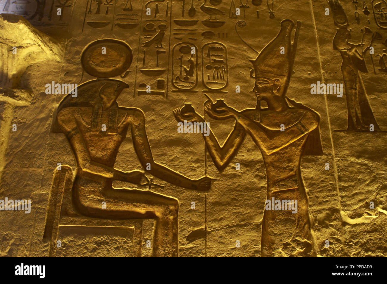 Egyptian art. Great Temple of Ramses II. 19th Dynasty. Relief depicting the pharaoh Ramses II making an offering to god Ra. 19th Dynasty. New Kingdom. Abu Simbel. Egypt. Stock Photo