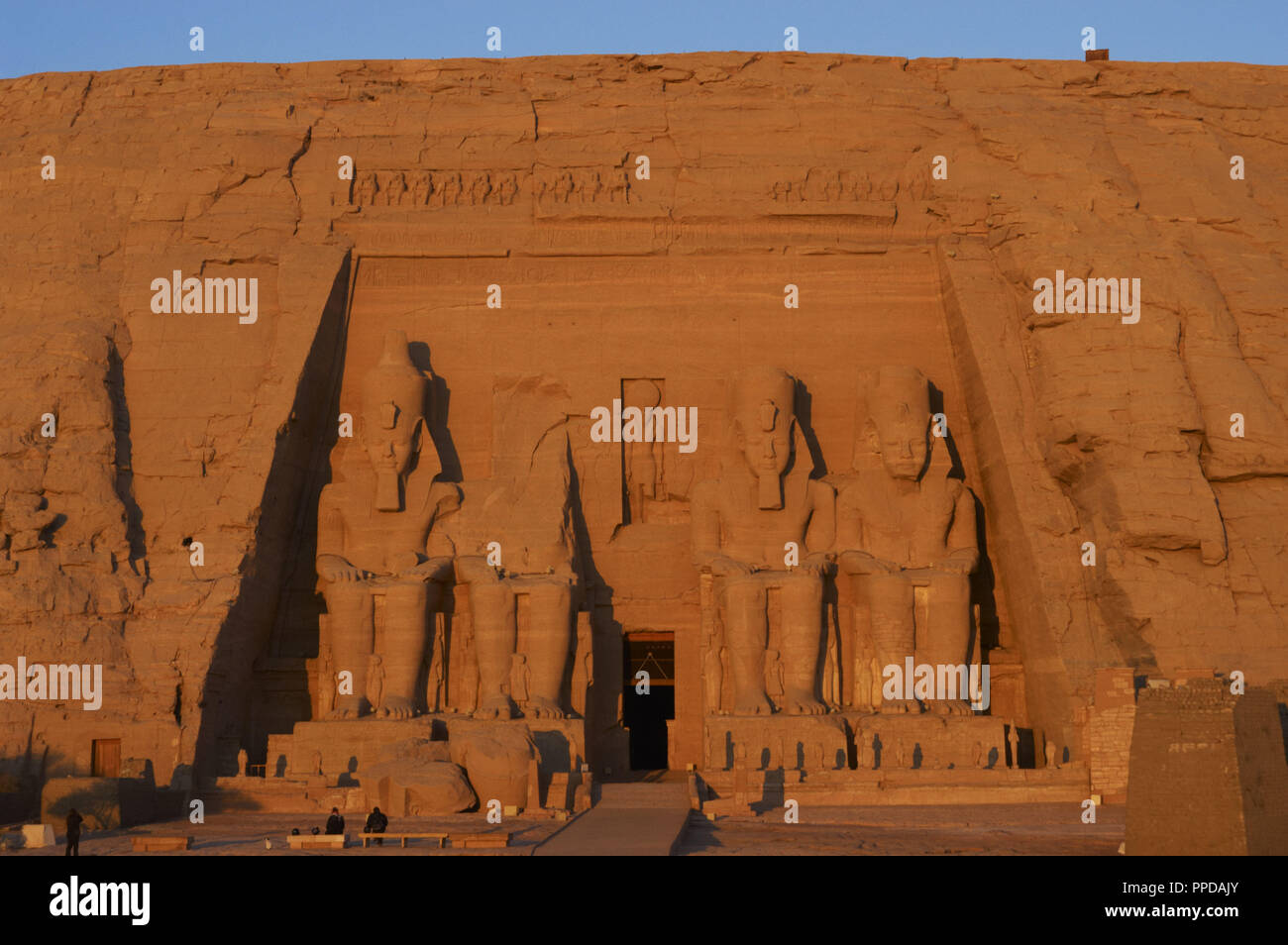 Egyptian art. Great Temple of Ramses II. Four colossal statues depicting the pharaoh Ramses II (1290-1224 BC) seated with the nemes head and surmounted by the double crown. 19th Dynasty. New Kingdom.  Abu Simbel. Egypt. Stock Photo