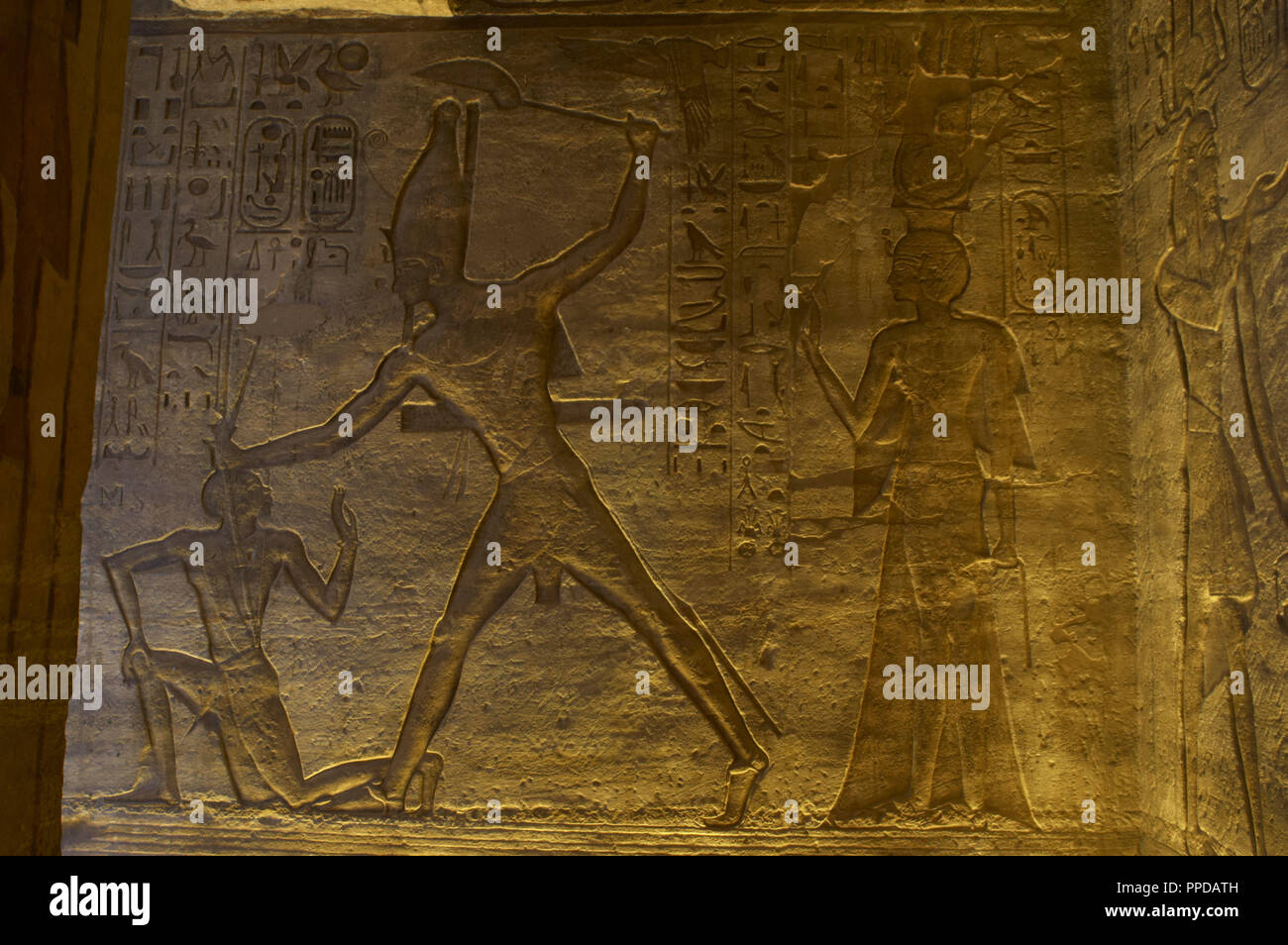 Egyptian art. Great Temple of Ramses II. 19th Dynasty. Relief depicting the victorious pharaoh Ramses II with an enemy been captured. 19th Dynasty. New Kingdom. Abu Simbel. Egypt. Stock Photo
