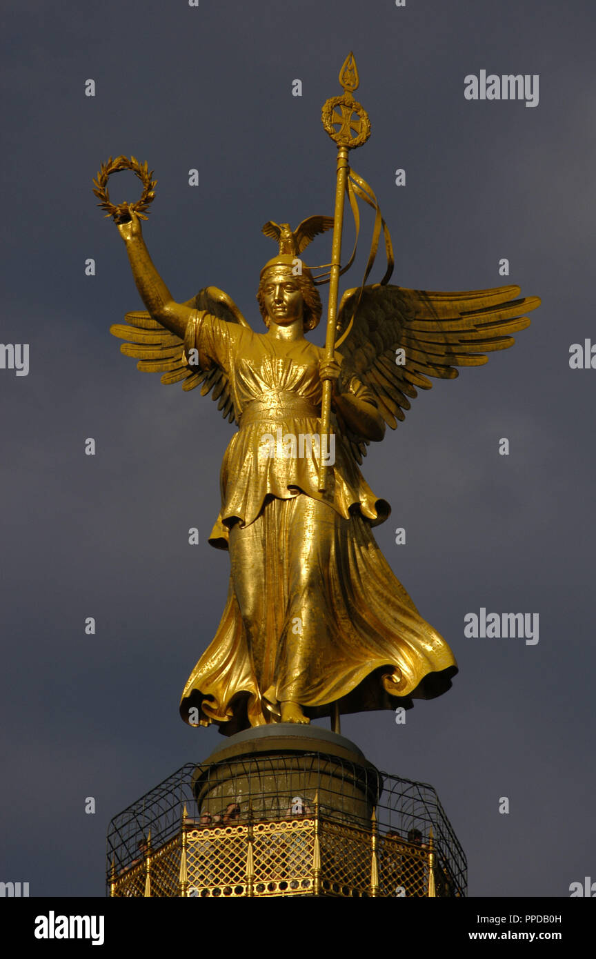 Germany. Berlin. Bronze sculpture of Victoria, designed by the German sculptor Friedrich Drake (1805-1882), on the top of the Victory Column, wich was designed to commemorate the Prussian victories in the Danish-Prussian War, Austro-Prussian War and in the Franco-Prussian War. Tiergarten Park. Stock Photo