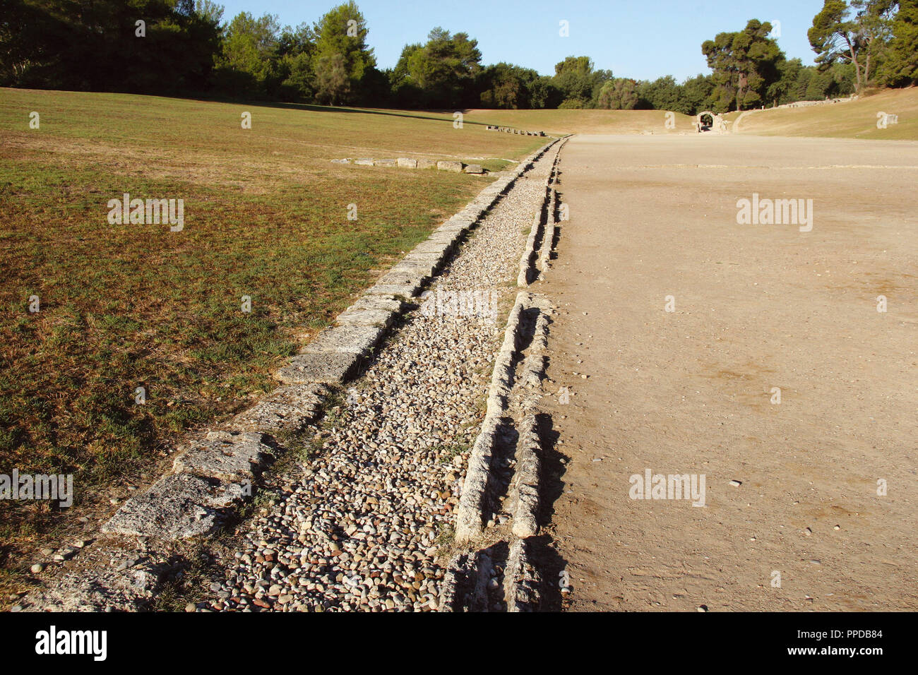Greek Art. Sanctuary of Olympia. Panorama of the ancient Olympic Stadium. Detail of the water channel. The east of archaelogical site.  Elis. Peloponesse. Greece. Europe. - Stock Image