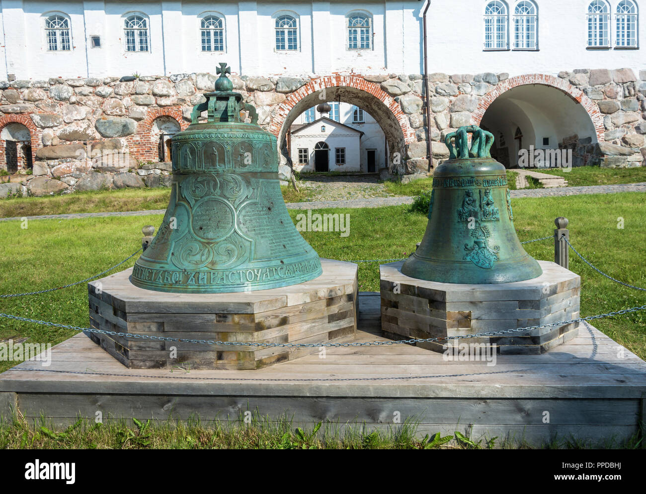 Vintage bell with traces of bullets in the courtyard of the Spaso-Preobrazhensky Solovetsky monastery, Arkhangelsk oblast, Russia. Stock Photo