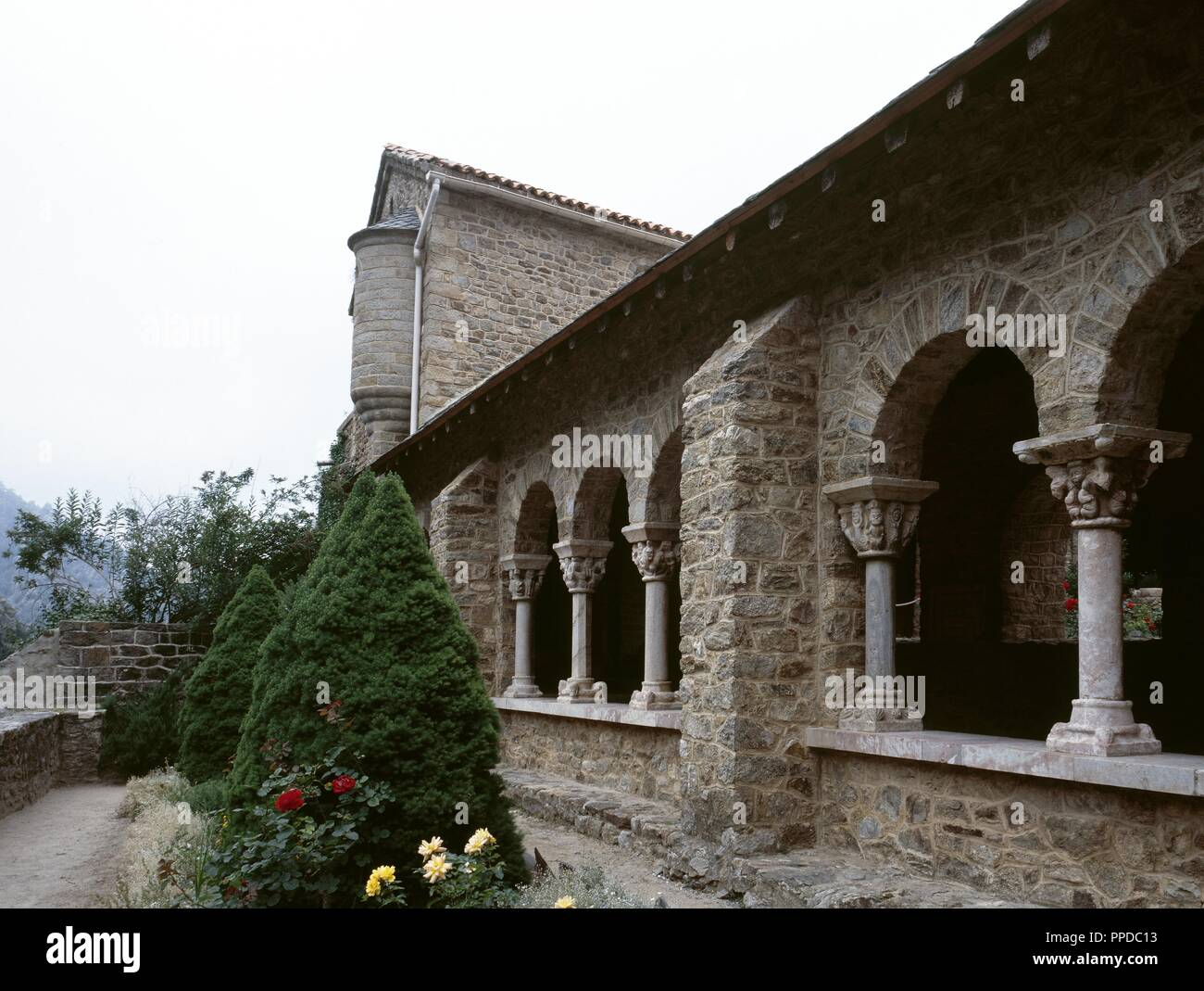 France. Pyrenees-Orientales. Languedoc-Roussillon region. Abbey of Saint-Martin-du-Canigou. Monastery built in 1009, on Canigou mountain. It was built from 1005-1009 by Guifred, Count of Cerdanya in Romanesque style. Architectural detail of the  Cloister. Restoration of 1900-1920. Stock Photo