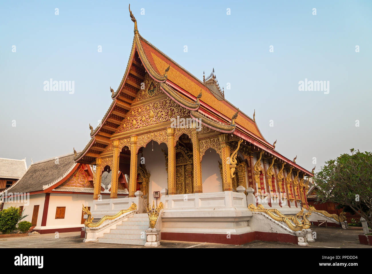View of the Buddhist Vat Nong Sikhounmuang Temple in Luang Prabang, Laos, in the late afternoon. - Stock Image